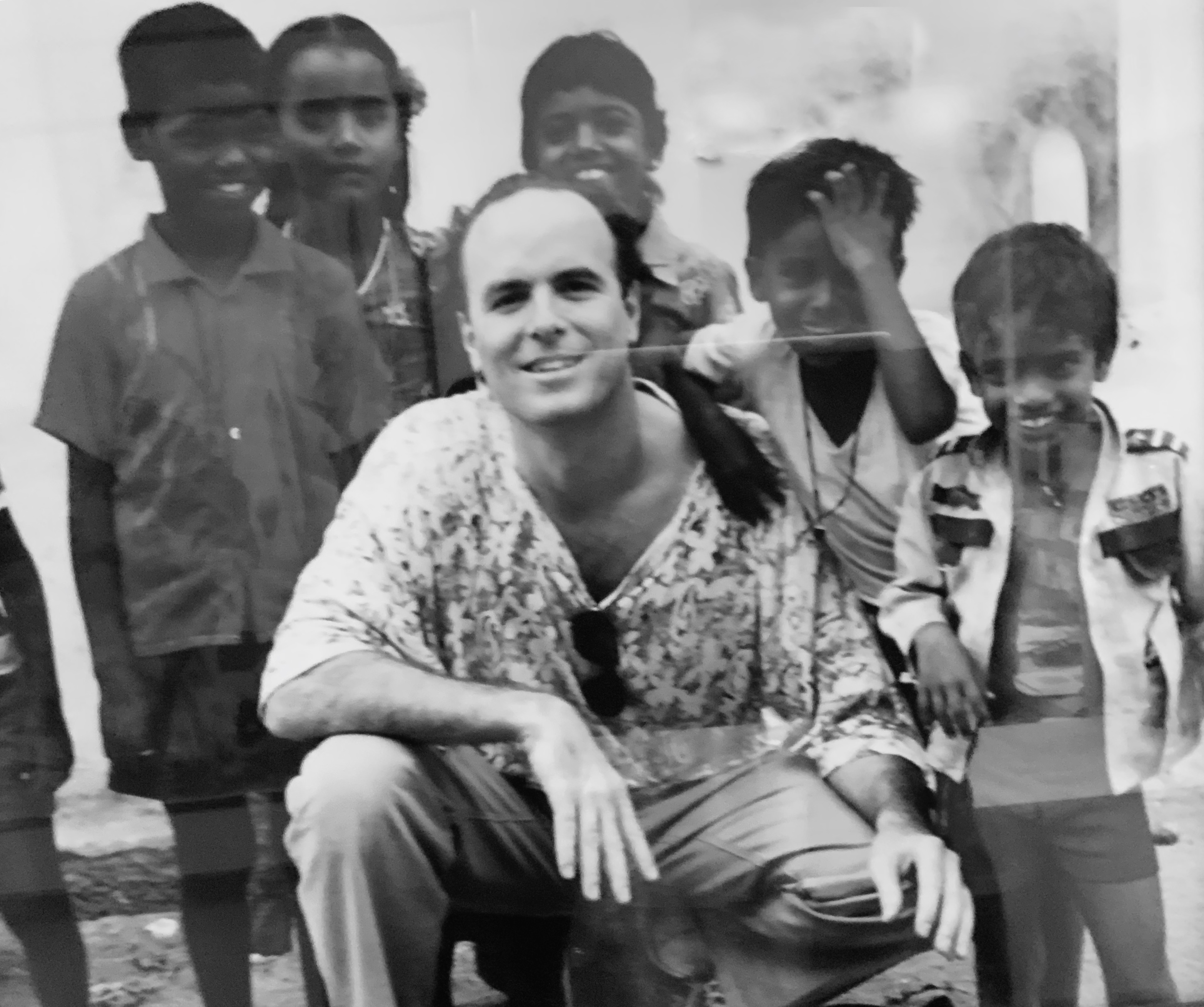 Dr Weiss with kids in India